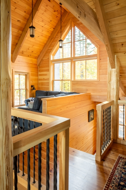 wood beam ceiling, stair and baluster detail, pine board walls, post and beam