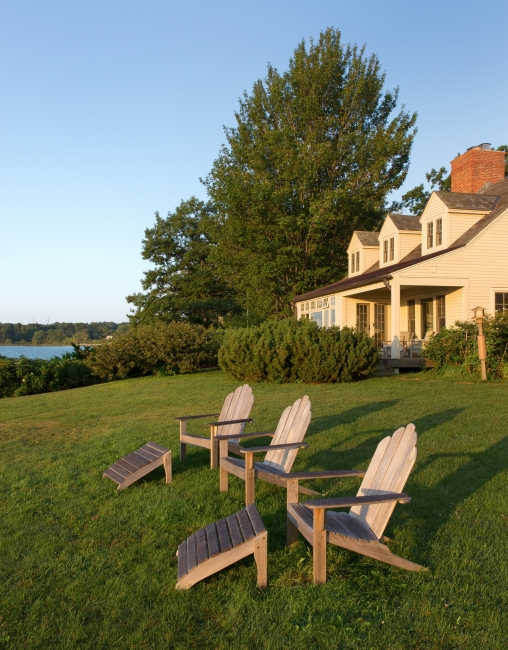 Renovated farm house on water, Adirondack chairs, the way life should be, Maine