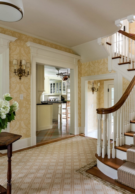 Foyer, stairs and wallpaper
