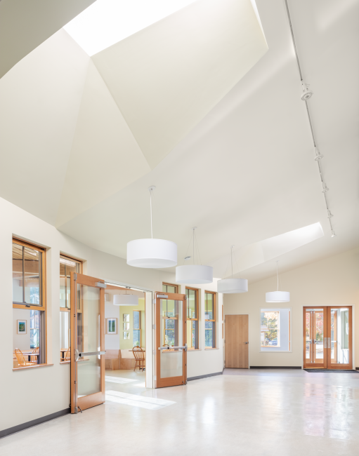 Hallway and entrance, light coming in from skylights, Maine Coast Waldorf School Community Hall