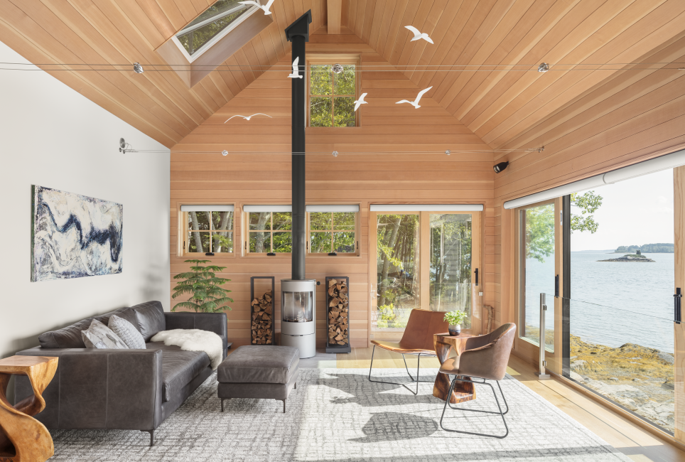Living room with windows over Casco Bay