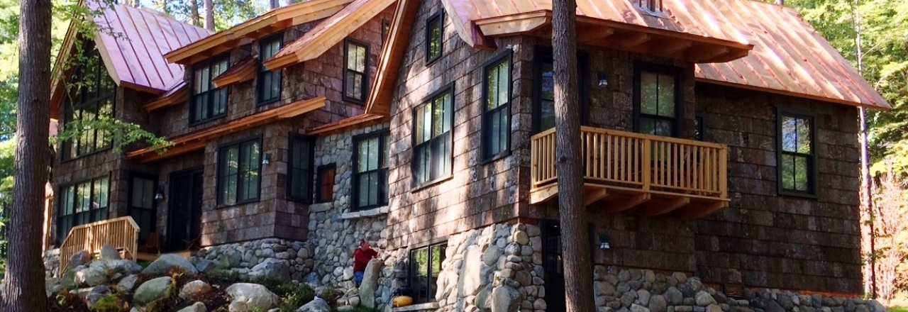 Bark siding and copper roof