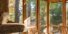 Screen porch with stone fireplace, Rough stone tile floor