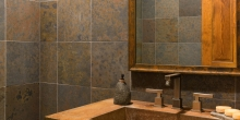 Bathroom, concrete counter top and wall tile
