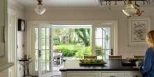 Kitchen Island looking out to patio and garden through double doors