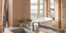 Bathroom with floating tough sink, bathtub with water views