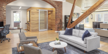 office meeting area, class A office space, brick archway, wood beams