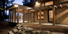 Screened in porch and cedar pergola, evening house and lake