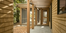 Cedar shingle siding, granite pavers, pergola