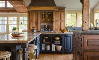 Kitchen with stone counter top Island hood and rustic wood floors