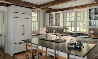 Kitchen with island and counter top bar, antique post and beam ceiling