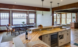 Kitchen with wet bar and water views, dinning table
